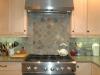 Custom stone detail over gormet stove